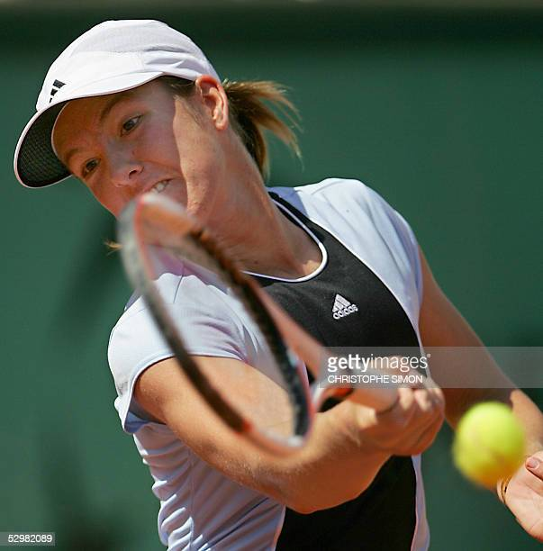 Justine HeninHardenne jubilates returns the ball to Spain Virginia Ruano Pascual during their second round match of the tennis French Open at Roland...