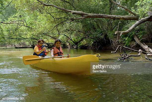 France, Landes, Eyre river. Mother and teenage daughter (14-15 years) canoeing
