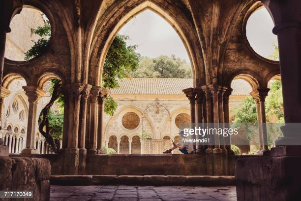 France, Languedoc, Narbonne, Frontfroide Abbey, boy listening to the audio guide