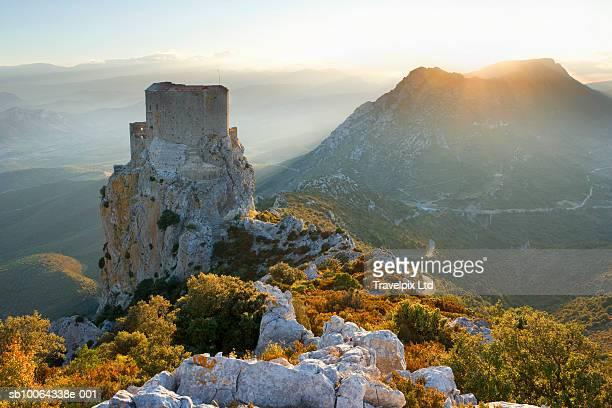 france, languedoc-roussillon, chateau de queribus at sunset - languedoc rousillon stock pictures, royalty-free photos & images