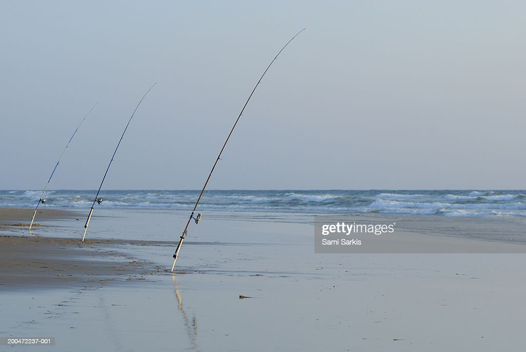 France, Le Porge beach, three fishing rods on beach, outdoors : Stock Photo