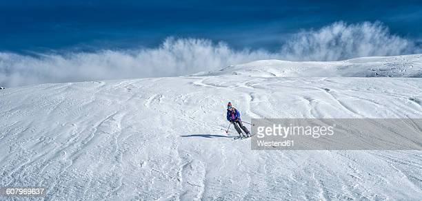 france, les contamines, ski mountaineering, downhill - female skier stock pictures, royalty-free photos & images