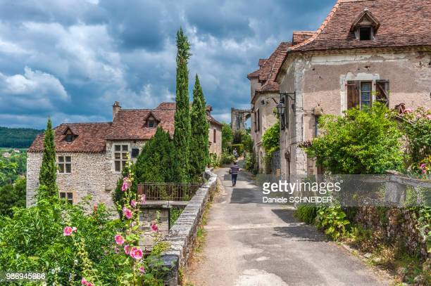 """france, lot, causses du quercy regional natural park, st cirq-lapopie, labelled """"most beautiful village in france - midi pyrénées stock photos and pictures"""
