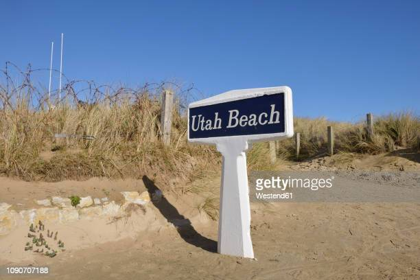 france, lower normandy, manche, sainte marie du mont, utah beach, barbed wire fence and sign utah beach - utah beach stock photos and pictures