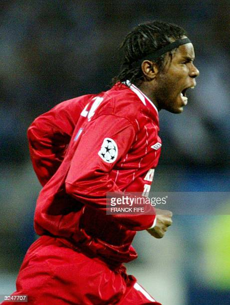 Lyon French forward Peguy Luyindula jubilates after his goal during their Champions League quarterfinal second leg football match against Porto 07...