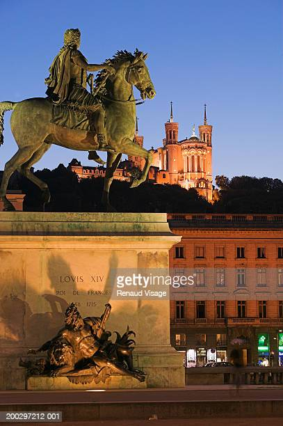 France, Lyon, Place Bellecour, Statue of Louis XIV on horse, dusk