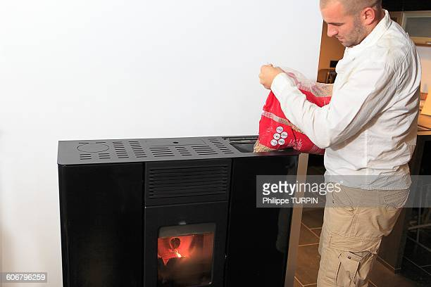 France, man filling a stove