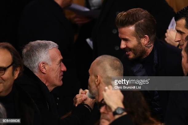 France manager Didier Deschamps greets David Beckham ahead of the UEFA Champions League Round of 16 Second Leg match between Paris SaintGermain and...