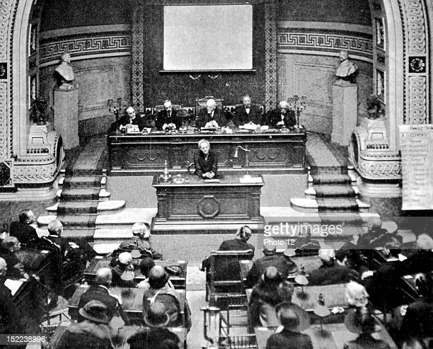 France Marie Curie giving a lecture on radioactivity at the Academy of Medicine in Paris