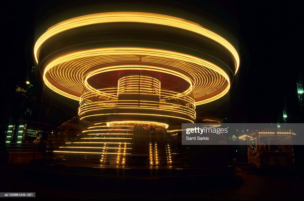 France, Marseille, spinning old fashioned carousel at night : Stock Photo