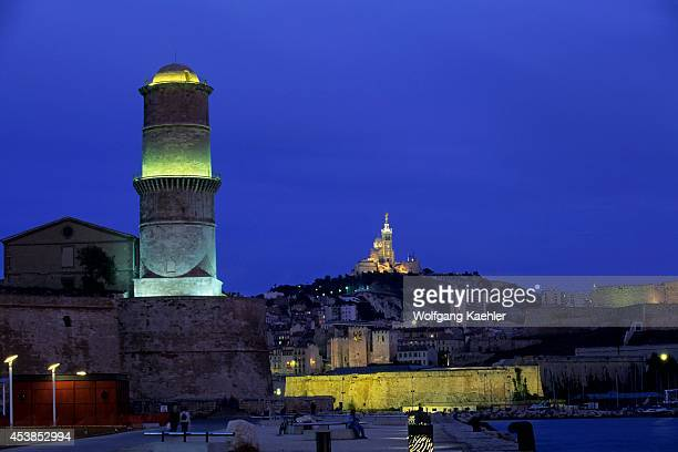 France Marseilles Entrance To Old Port Notre Dame De La Garde Church On Hill Top At Night