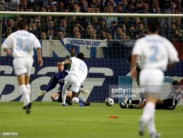 Marseille's Ivorian forward Didier Drogba scores a goal during the UEFA Cup semifinal second leg football match against Newcastle 06 May 2004 at the...