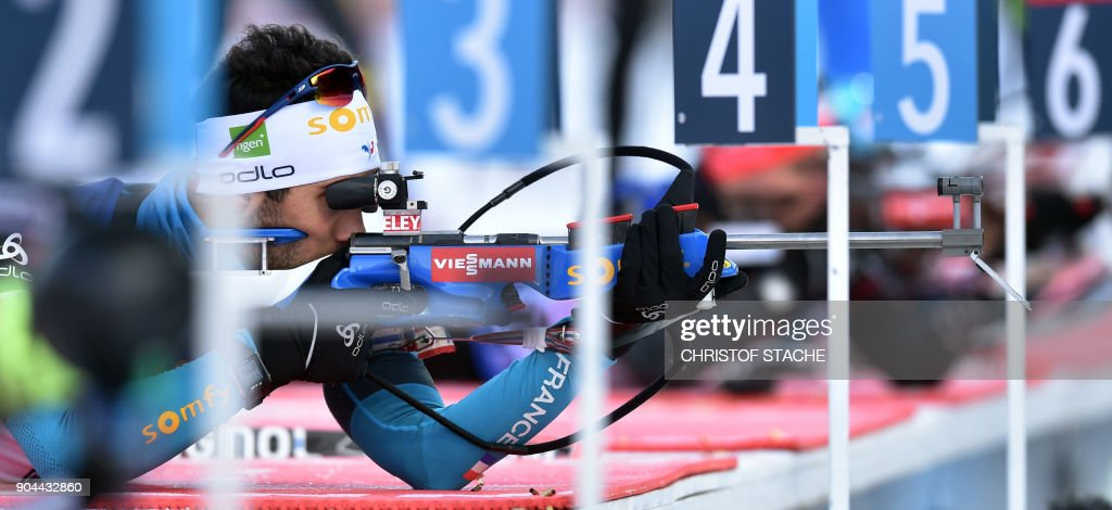 France Martin Fourcade shoots during the warm up shooting prior to the men's 4 x 7,5km relay event at the Biathlon World Cup on January 12, 2018 in Ruhpolding, southern Germany. /