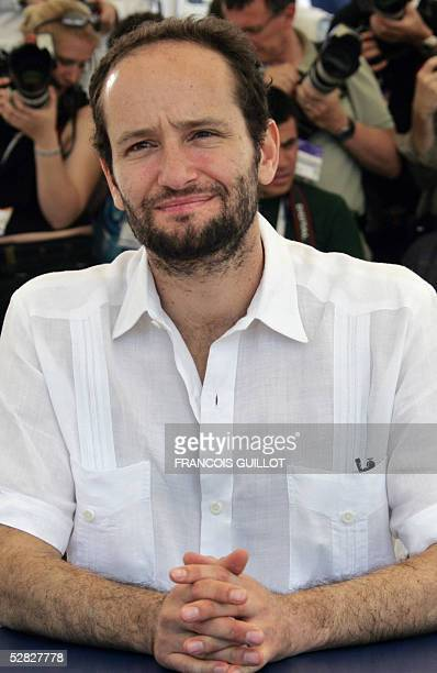 """Mexican director Carlos Reygadas poses during a photo call for his film """"Batalla en el Cielo"""" , 15 May 2005 during the 58th edition of the Cannes..."""