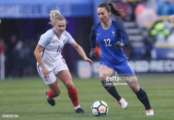 France midfielder Gaetane Thiney controls the ball as England midfielder Isobel Christiansen pursues during the second half of the international game...