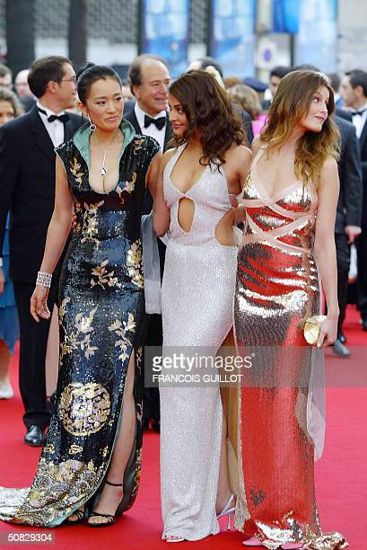 Models Gong Li Aishwarya Rai and Laetitia Casta arrive for the opening ceremony at the 57th Cannes International Film Festival 12 May 2004 in the...