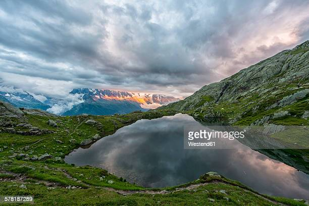 France, Mont Blanc, Lake Cheserys, Mont Blanc reflected in the lake in a stormy day at sunset