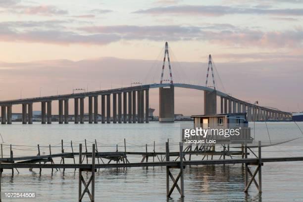 france, mouth of the loire, saint-nazaire bridge and fisheries. - loire atlantique photos et images de collection