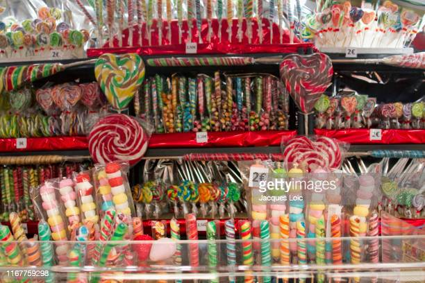 france, nantes, 44, christmas market, lollipops stand - sweet shop stock pictures, royalty-free photos & images