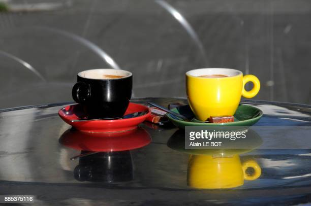 France, Nantes city, two coffee cups on a bistro table, coffee shop.