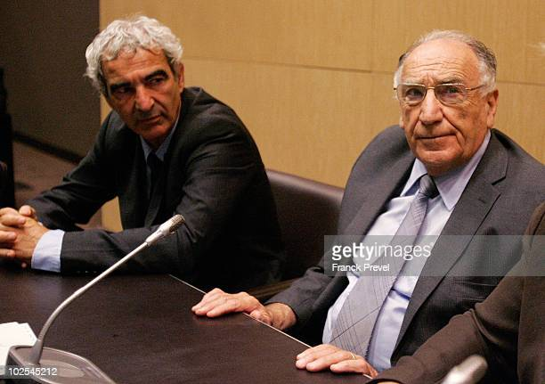 France national team coach Raymond Domenech and exFrench Football Federation president JeanPierre Escalettes attend a hearing in front of the...