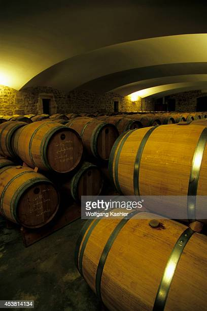 France Near Bordeaux Chateau Cantin Wine Barrels In Cellar