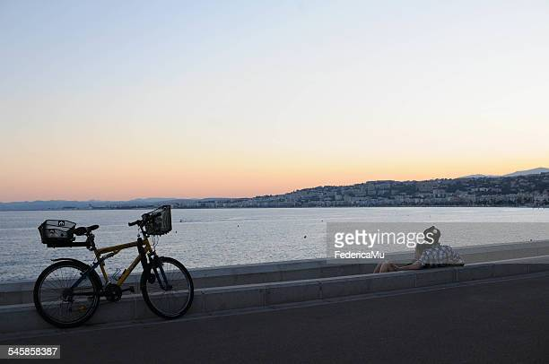 France, Nice, Young couple looking at sunset