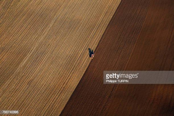 France, Norhern France, Pas-de-Calais. Aerial view of an agricultural vehicle in a field