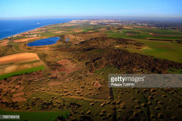 France, Norhern France, Pas-de-Calais. Town of Sangatte, Bleriot-Plage. Blanc-Nez Cape. Noires-Mottes, ground riddled with bomb holes. Front Pignon Lake, the fillage of Sangatte and Calais in the background.