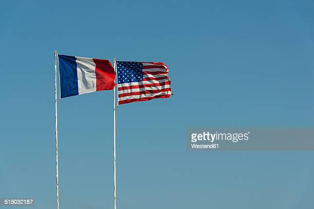 France, Normandie, Manche, Sainte Marie du Mont, Utah Beach, French and US flag waving against blue sky