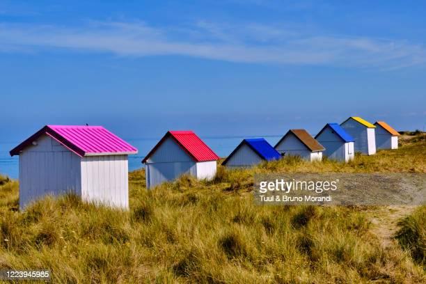 france, normandy, manche department, gouville-sur-mer, the beach huts of gouville - cabine de plage photos et images de collection