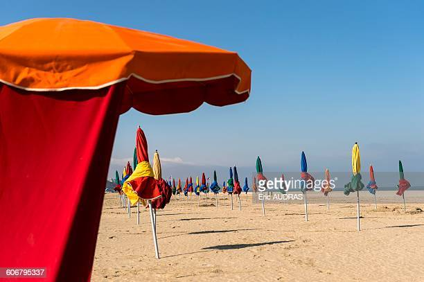 France, Normandy, the beach of Deauville with typical beach umbrellas in many colors