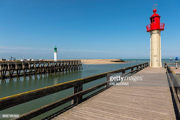 france, normandy, the lighthouse from trouville on a beautiful summer day - trouville sur mer stock pictures, royalty-free photos & images