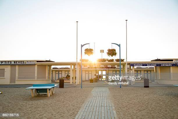 france, normandy, trouville, beach front at sunset - trouville sur mer stock pictures, royalty-free photos & images