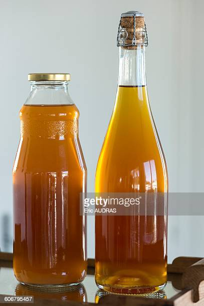 France, Normandy, two bottles of apple juice and cider from Normandy