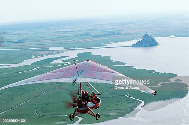 france, normandy, ultralight over mont saint-michel, aerial view - aereo ultraleggero foto e immagini stock