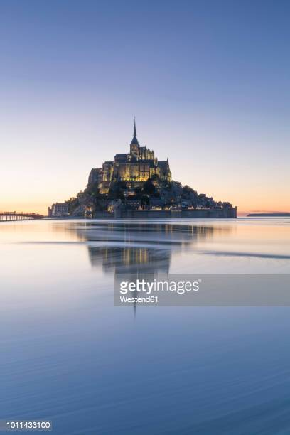 france, normandy, view to lighted mont saint-michel, blue hour - モンサンミッシェル ストックフォトと画像