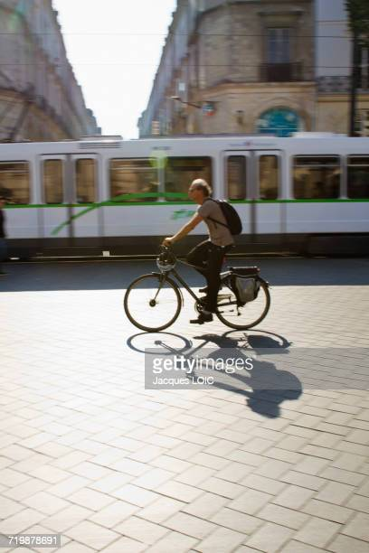 France, North Western France, Nantes, cyclist passing in front of a tram.