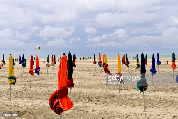 France, Northern France, Lower Normandy, Deauville, seafront, beach before the storm, umbrellas