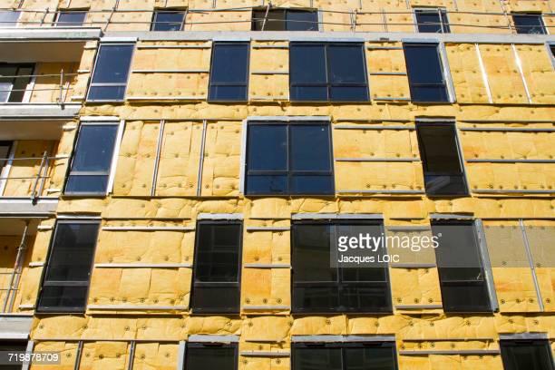 france, north-western france, nantes, insulation work on a new building - isoliert stock-fotos und bilder