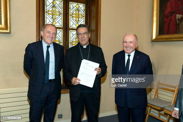 France – October 01 : Francois-Henri Pinault, Paris Archbishop Michel Petit and Francois Pinault sign paper work for a 100 millions euros donation to...