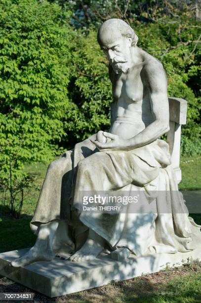 France, Paris, 5th district. Jardin des plantes. The statue  Science and mystery  by Jean-Louis-Desire Schrder (1889); a philosopher wonders about the origin of life by meditating on an egg