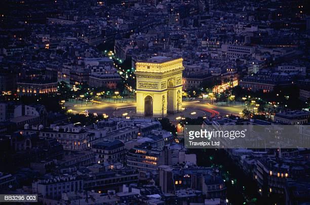 France, Paris, Arc de Triomphe, illuminated at night, aerial view