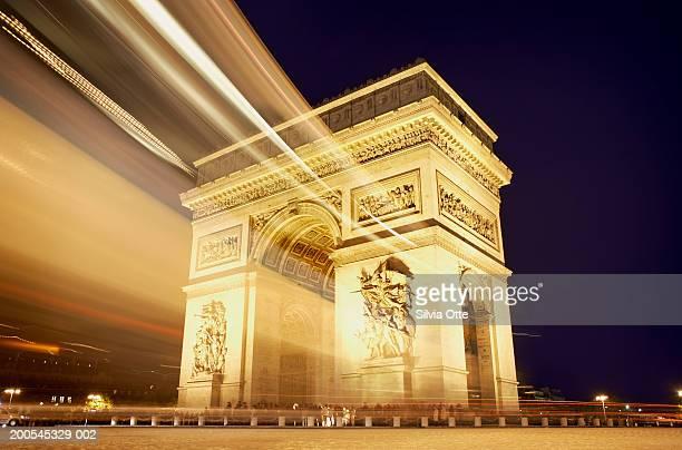 France, Paris, Arc de Triomphe illuminated at night (long exposure)