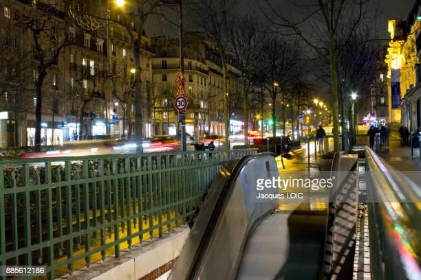 France, Paris, Avenue des Gobelins, Gobelins subway exit at night.