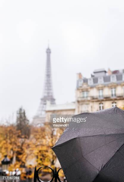 France, Paris, black umbrella with the Eiffel Tower in the background