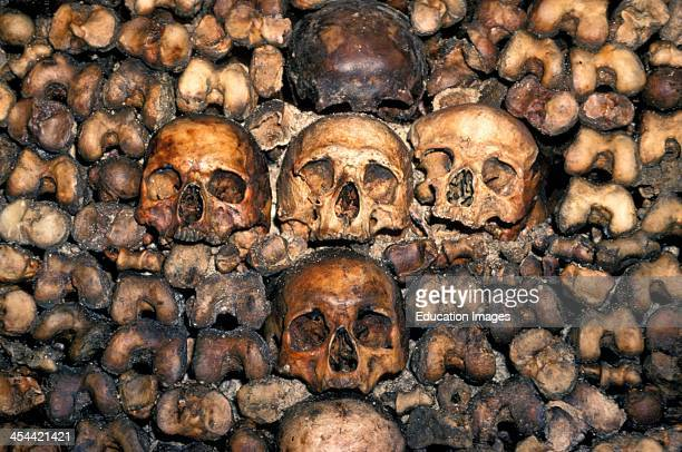 France Paris Catacombes CloseUp Of Wall Lined With Skulls