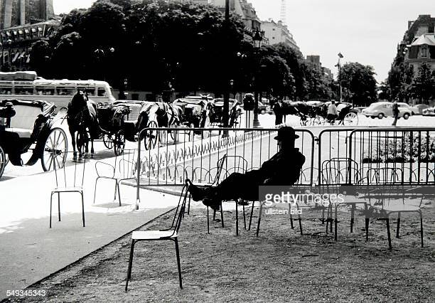 France Paris coachman with bowlerhat sleeping on parkchair in the shadow