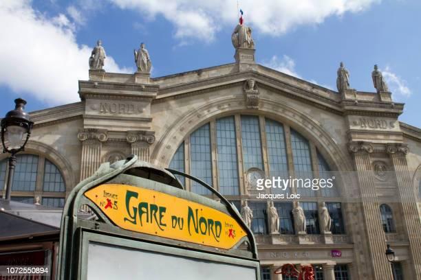 france, paris, department 75, 10th arrondissement, train station gare du nord, metro entrance and façade of the train station. - gare du nord stock pictures, royalty-free photos & images