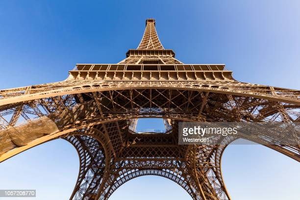 france, paris, eiffel tower, worm's eye view - eiffel tower paris stock pictures, royalty-free photos & images